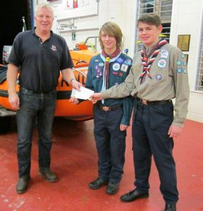 Dom and Criag receive cheques from DLA Jules Hewson.