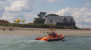 Air ambulance landing with Hayling Rescue boat