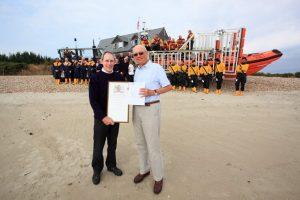 Gil receiving awards