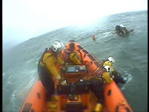 casualty being pulled into the lifeboat
