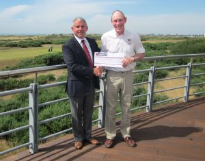 Clu Caption Jamie Leggett presenting the chaque to RNLI Station Manager.